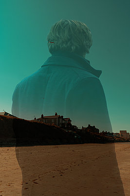 Collage, Transparent person looks at the village - p1681m2283691 by Juan Alfonso Solis