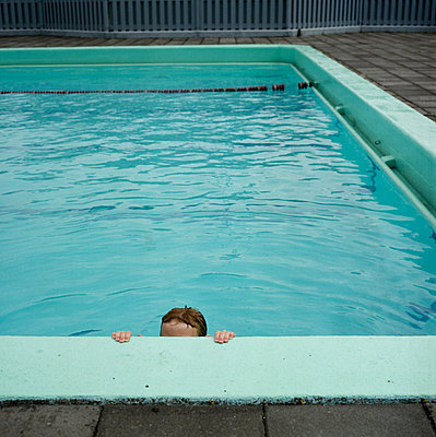 A child climbing up from a swimming-pool - p348m733672 by Bragi Thor Josefsson