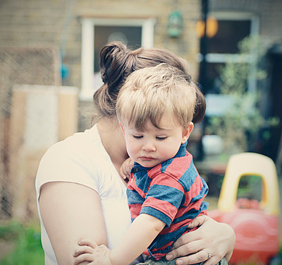 Mother holding Son - p694m2200713 by Novo Images