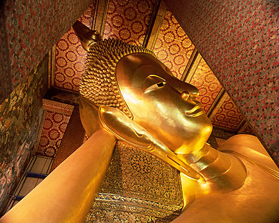 Detail of the head of the 46m long statue of the Reclining Buddha, Wat Pho (Wat Po) (Wat Chetuphon), Bangkok, Thailand, Southeast Asia, Asia - p8710219 by Gavin Hellier