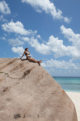 Woman on the rocks - p0452395 by Jasmin Sander