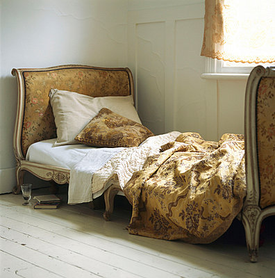 Upholstered vintage style single bed with embroidered bed linen - p349m695253 by Emma Lee