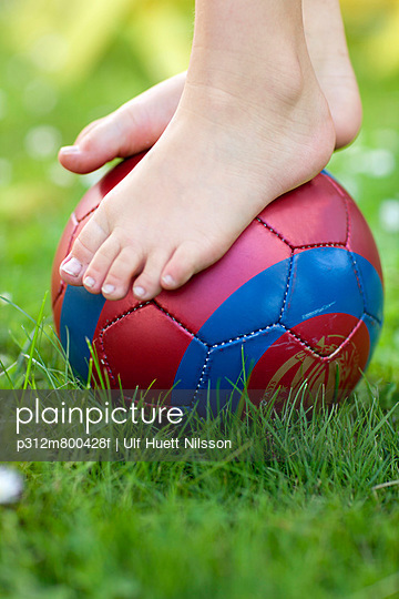 Childs feet on ball, close-up