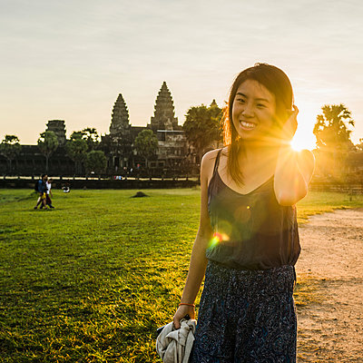 Woman in front of Angkor Wat temple, Siem Reap, Cambodia - p924m1197551 by Rosanna U