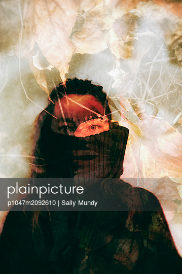 Collaged abstract portrait of womans face overlaid with close-up autumnal plant leaves   - p1047m2092610 by Sally Mundy