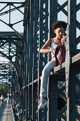 Female teenager on bridge - p728m2038819 by Peter Nitsch