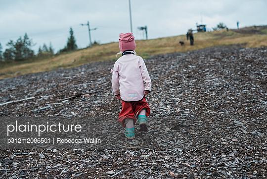 Girl walking - p312m2086501 by Rebecca Wallin