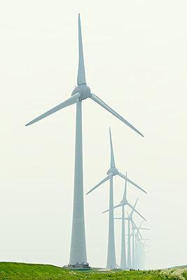 Row of wind turbines in field dyke landscape - p429m1469398 by Mischa Keijser