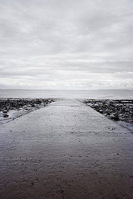 Concrete slipway going into calm sea on grey cloudy day - p5970204 by Tim Robinson
