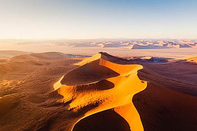 Sossusvlei, Namib-Naukluft National Park, Namibia, Africa. Aerial view of the sand dunes at sunrise. - p651m2033366 by Marco Bottigelli