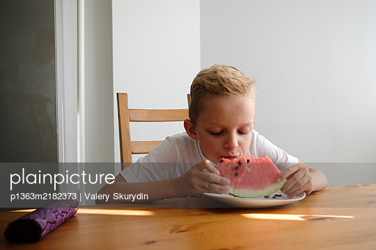 Boy eating watermelon - p1363m2182373 by Valery Skurydin