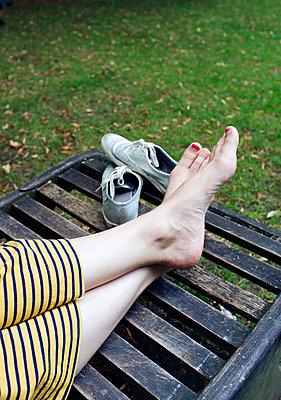 Woman relaxing on a Bench - p1096m931752 by Rajkumar Singh