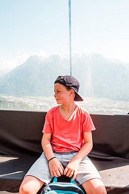 Boy resting on peak, Bludenz, Vorarlberg, Austria - p429m2153045 by ©JFCreatives