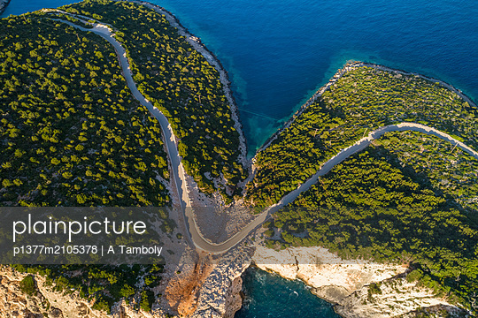 Greece, Ionian Islands, Lefkada island, Ionian sea, Greek Islands, Aerial of a curvy dangerous road over a cliff that leads to Cape Lefkadas - p1377m2105378 by A Tamboly