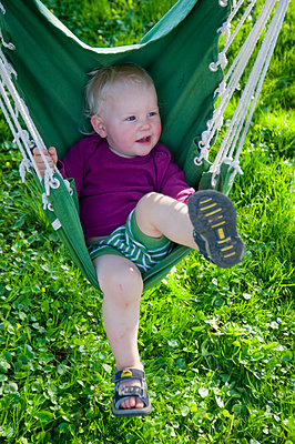 Child on a swing - p116m1586228 by Gianna Schade