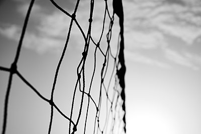 Volleyball net against the sky, in black and white - p1423m2210723 by JUAN MOYANO