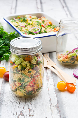 Preserving jar of Couscous salad with tomatoes, cucumber, parsley and mint - p300m2012846 by Larissa Veronesi