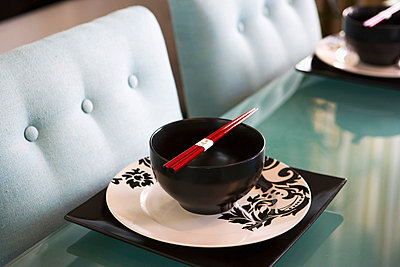 Contemporary Dining Table with Place Settings and Chopsticks - p5550908f by LOOK Photography