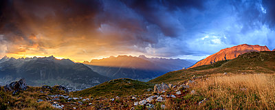 Panorama of the fiery sky on high peaks of Muottas Muragl at sunset, St. Moritz,  Canton of Graubunden, Engadine, Switzerland, Europe - p871m1478741 by Roberto Moiola