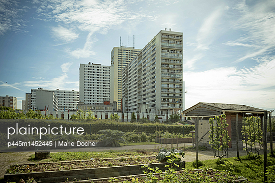 Apartment buildings next to allotment gardens - p445m1452445 by Marie Docher