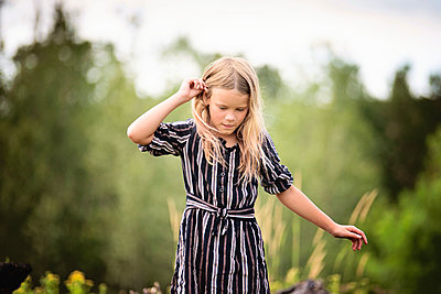 Young Blond Girl in a Field - p1166m2207811 by Cavan Images
