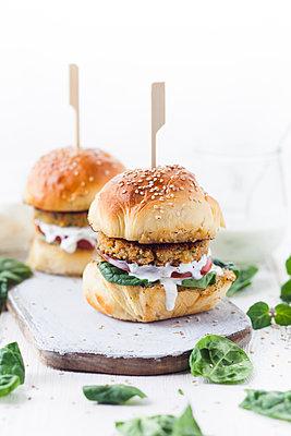 Vegetarian Burger with Halloumi Zucchini Carrot Patty, Tzatziki sauce, homemade bun - p300m1470064 by Susan Brooks-Dammann