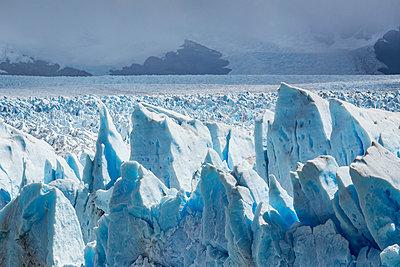Storm clouds over Perito Moreno Glacier, Los Glaciares National Park, Patagonia, Chile - p429m1495974 by Manuel Sulzer
