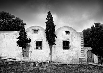 Cypress trees in front of vintage chapel in Crete - p1445m2128464 by Eugenia Kyriakopoulou