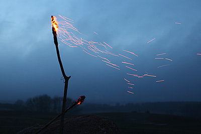 Torches and flying sparks at sunset - p1519m2063304 by Soany Guigand