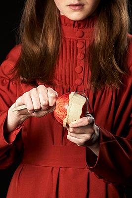 Girl peeling an apple - p1540m2271364 by Marie Tercafs