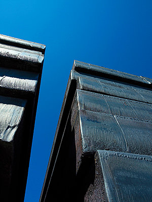 Steel billets against blue sky - p42916999 by Charlie Fawell