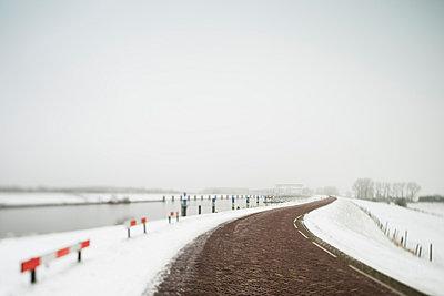 Rural road in snowy landscape - p429m817460 by Mischa Keijser
