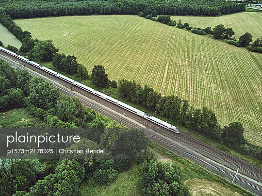 Inter City express in the landscape - p1573m2178925 by Christian Bendel
