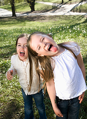 Sisters making funny faces - p4263004f by Maskot