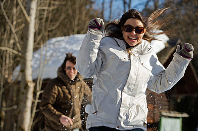 Couple in casual ski wear. - p4295484 by Ross Woodhall