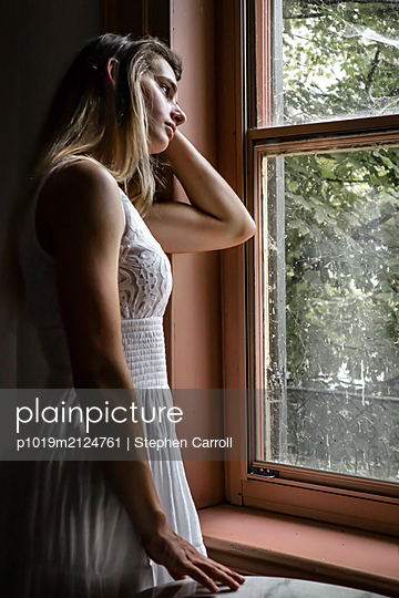 Looking out of window - p1019m2124761 by Stephen Carroll