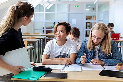 Teenage girls in classroom - p312m2145662 by Susanne Kronholm