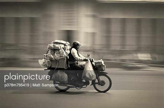 Speeding overloaded moped - p378m795419 by Matt Sampson