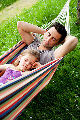 Father And Daughter Sleeping In Hammock - p4295806f by Brigitte Sporrer