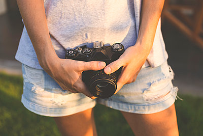 Woman with vintage camera - p300m1153624 by Konstantin Trubavin