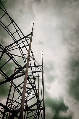 Old roller coaster against a stormy sky - p1228m1123036 by Benjamin Harte