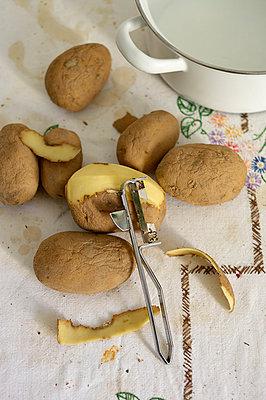 Peeling potatoes - p358m1003408 by Frank Muckenheim