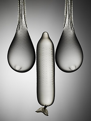 Still life of condoms suggesting male and female anatomy - p429m859969 by Justin Officer