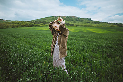 Woman with her hands clasped in field in Crimea, Ukraine - p1427m2163659 by Oleksii Karamanov