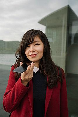 Portrait of businesswoman using smartphone - p300m2155182 by Hernandez and Sorokina