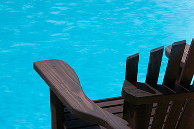 Wood Deck Chair by Swimming Pool - p5550511f by LOOK Photography