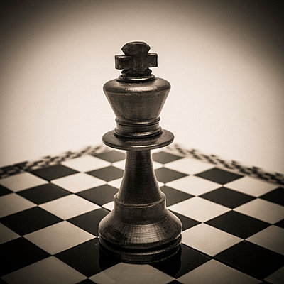 The king placed in the center of the chessboard. - p813m1222296 by B.Jaubert