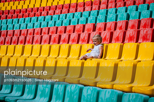 Toddler girl in a stand, Friedrich-Ludwig-Jahn-Sportpark - p1093m2193628 by Sven Hagolani