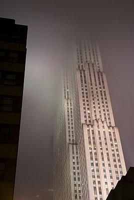 Upward View of Rockefeller Plaza on a Foggy Night - p5690204 by Jeff Spielman