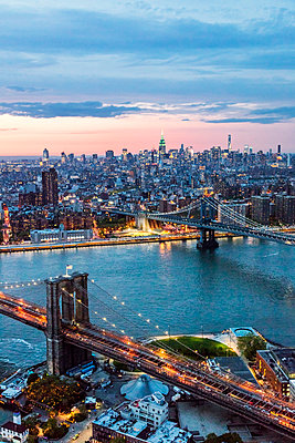 Aerial of Midtown Manhattan with Empire state building and East river at dusk, New York, USA - p651m2007172 by Matteo Colombo photography